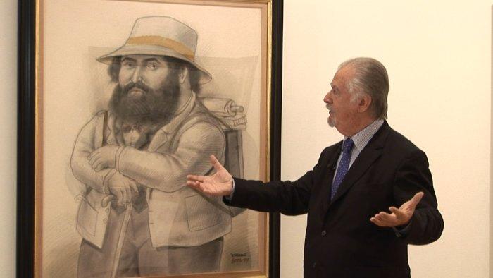 Der Maler erklärt eines seiner Werke